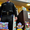 Toy Drive Organizer and State Police Sergeant stands by some of the yield